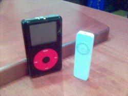 iPod Shuffle beside U2 iPod.jpg