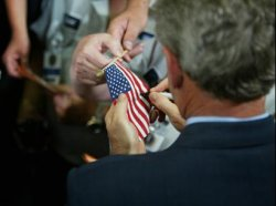 bush tags the flag.jpg
