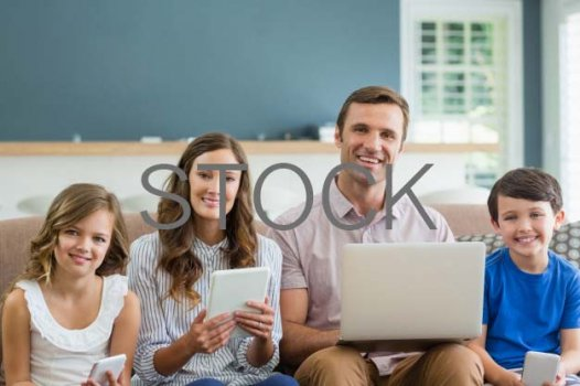 smiling-family-using-digital-tablet-phone-laptop-living-room-home_107420-61806.jpg